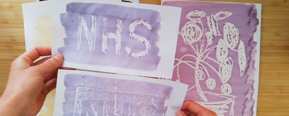 A still from an online workshop video of an artist who has made purple wax and ink drawings